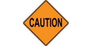 Orange-colored caution sign